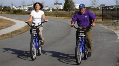 couple biking together | Ward Realty Topsail Island