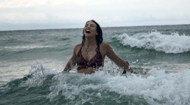 happy woman swimming in the ocean | Ward Realty Topsail Island