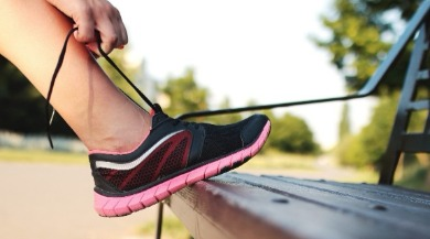 woman putting on sneakers to walk | Ward Realty Topsail Island