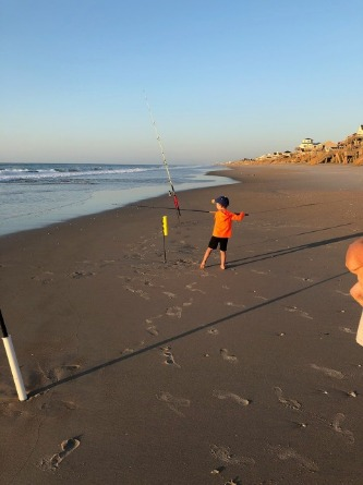 Boy fishing on Topsail Island | Ward Realty