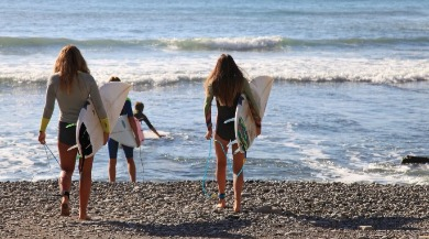 group of friends surfing | Ward Realty Topsail Island
