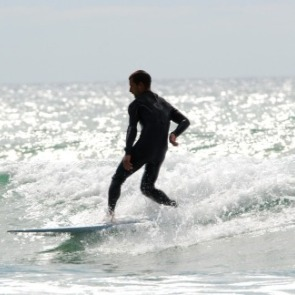 man surfing | Ward Realty Topsail Island