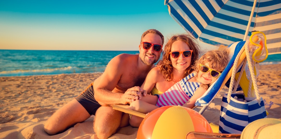 family enjoying the beach with their essential items | Ward Realty