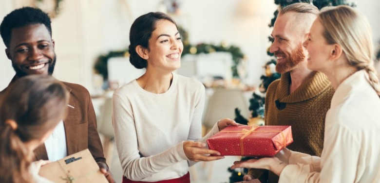 woman giving party host a gift | Ward Realty