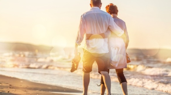 couple walking along the beach | Ward Realty