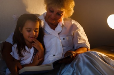 grandmother reading to her grandchild | Ward Realty Topsail Island