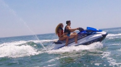 couple jet skiing | Ward Realty Topsail Island
